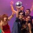 Young partying with disco ball — Stock Photo #19986697