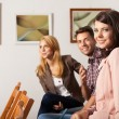 Young attractive at art show — Stock Photo