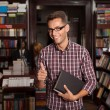 Thumbs up for shopping for books - Stock Photo