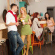 Young man courting a blonde girl in colorful cafe - Stok fotoraf