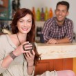 Red haired girl smiling in a cafe — Stock Photo