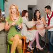 Happy socializing in colorful bar - Stock Photo