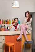 Young couple in colorful cafe — Foto Stock