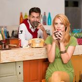 Beautiful couple drinking coffee — Stock Photo