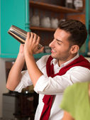 Hadsome bartender preparing a drink — Stock Photo