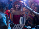 Young attractive girl laughing at party with dj — Stock Photo