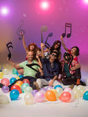 Happy group of friends surrounded with balloons — Stock Photo