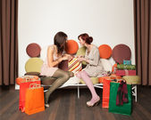 Girls with shopping bags laughing — Stock Photo