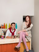 Attractive couple in colorful cafe — Stock Photo