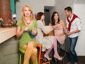 Happy socializing in colorful bar — Stock Photo