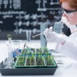 Stock Photo: Student analyzing in chemistry lab