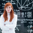 Stock Photo: Beautiful schoolgirl in laboratory