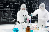 Scientists manipulating lab tools — Stock Photo