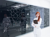 Schoolgirl at the blackboard — Stock Photo