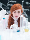 Student working in a chemistry lab — Stock Photo