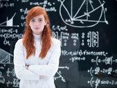 Beautiful schoolgirl in laboratory — Stock Photo