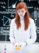 Student scanning in chemistry lab — Stock Photo