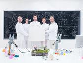Scientist team in laboratory — Stock Photo