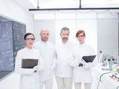 Researchers team in a chemistry lab — Stock Photo