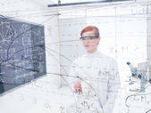 Student analyzing data and formulas — Stock Photo