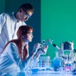 Scientists studying a molecular structure — Stock Photo #27701371