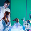 Young caucasiforensic scientics — Stock Photo #27701373