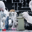 Laboratory scientists working with microscopes — Foto de Stock