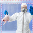 Biohazard technician warning of confirmed bird flu — Stock Photo