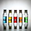 Five bottles with different coloured substance — Stock fotografie