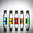 Five bottles with different coloured substance — Stockfoto