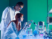 Scientists studying a molecular structure — Stock Photo