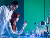 Forensic scientists studying a cartridge — Stock Photo
