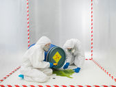 Checking a biohazard in a containment tent — Stock Photo
