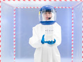 Person in protective suit holding biohazard samples — Stock Photo