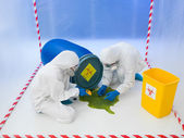 Attending to a biohazard chemical spill — Stock Photo