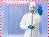 Person in biohazard suit calling a halt — Stock Photo