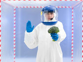 Person in biohazard suit warning about contamination — Stock Photo