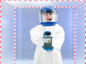Person in protective suit holding radioactive substance — Stock Photo