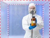Scientist holding deadly substance — Stock Photo