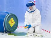 Specialist measuring level of contamination — Stock Photo