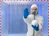 Person in biohazard suit warns against contaminantion — Stock Photo