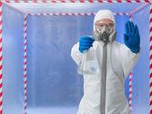 Person in biohazard suit calling a halt — Stock Photo