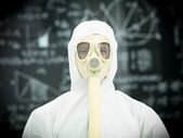 Protective geared person in front of blackboard — Stock Photo