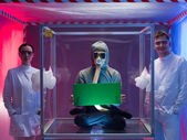 Proud scientists and their human subject — Stock Photo
