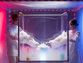 Experimenting with liquid nitrogen in protective enclosure — Stock Photo