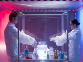 Conducting biohazard experiments in sterile chamber — Stock Photo