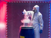 Experiments with steaming substances over waste barrel — Stock Photo