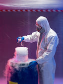 Engineer blending steaming chemical substances — Stock Photo