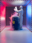Examining bio hazardous waste in containment tent — Stock Photo