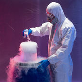 Scientist creating steaming chemical reactions — Stock Photo